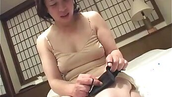 Babygirl gives her fine asian pussy a nice vibrator fuck