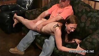 Big woman gets spanked while she is under the pillory