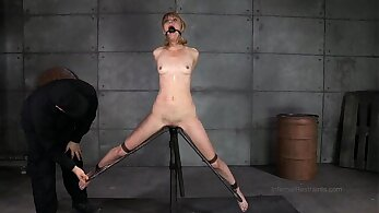 Blondie Hottie Monica Bliss in a speculum bondage