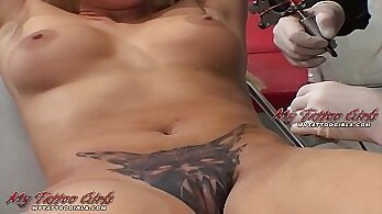 Asian model strokes her tattoo pussy in the shed